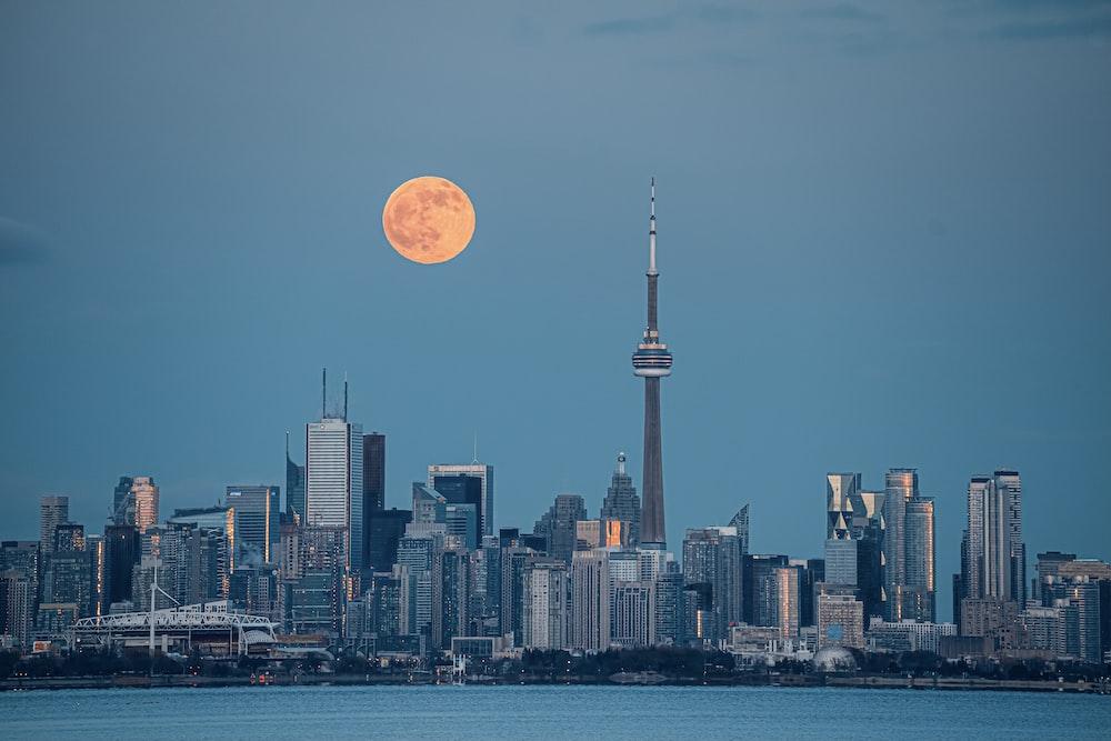 city skyline under full moon