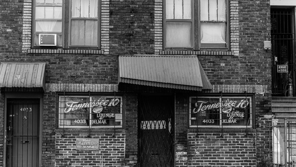 grayscale photo of brick building