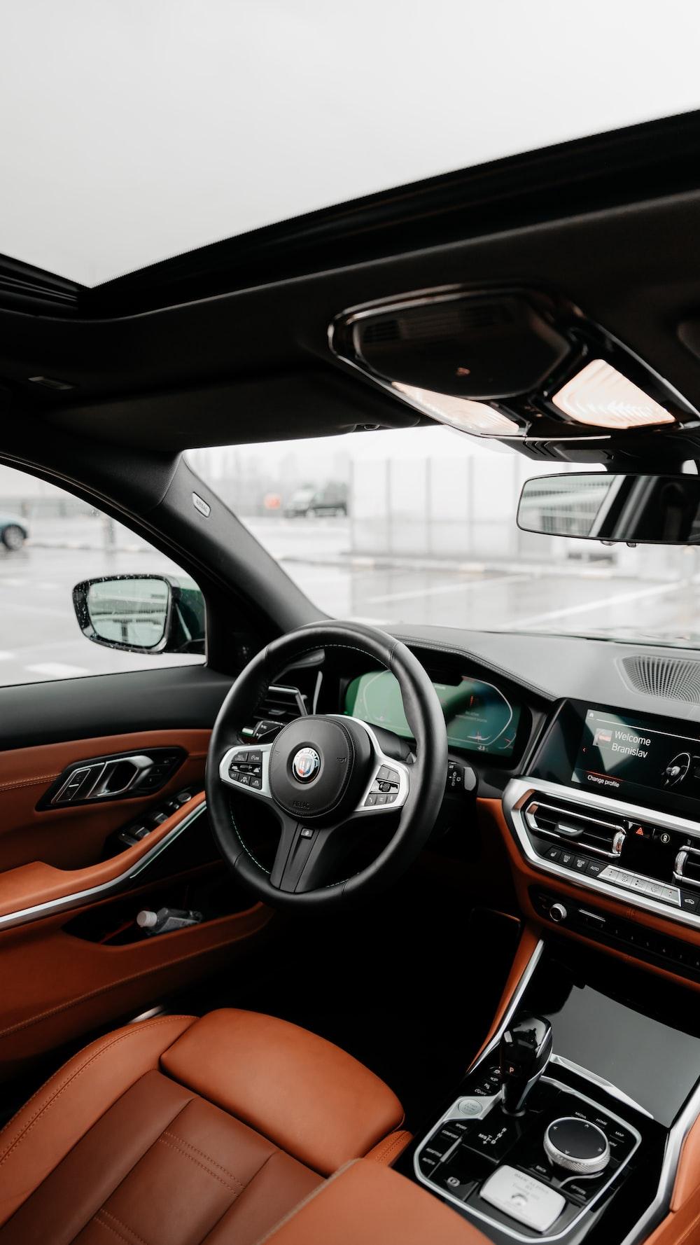black and brown bmw car steering wheel