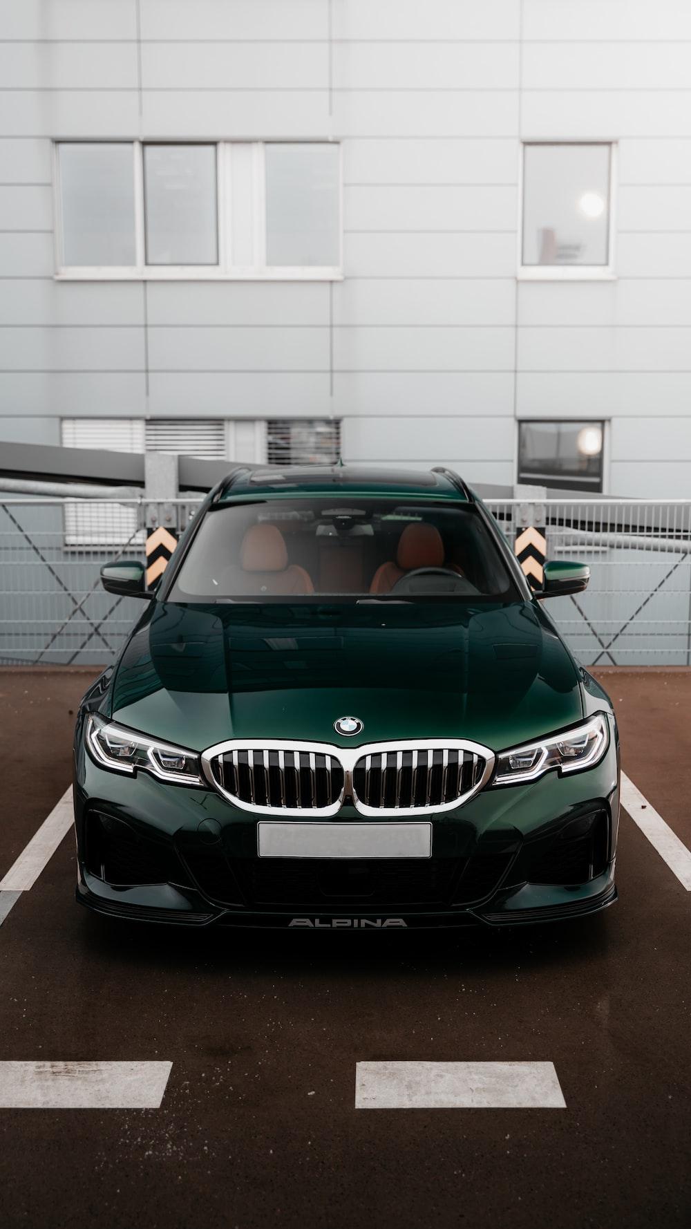 green mercedes benz car parked in garage