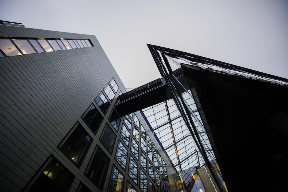 black metal frame near gray concrete building during daytime