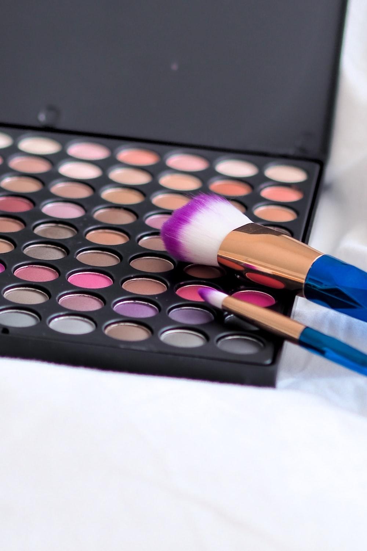 black make up brush on white surface