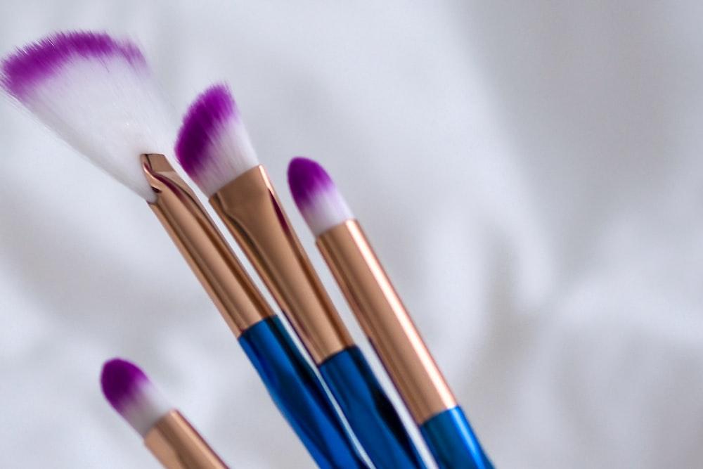 blue and brown makeup brush