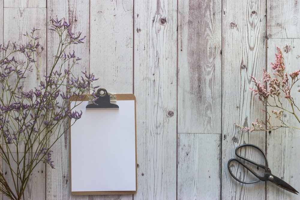 white wooden board on white wooden wall