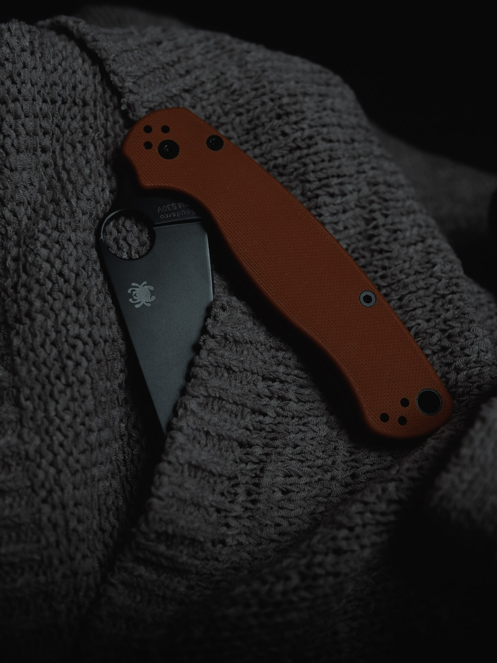 black and orange pocket knife