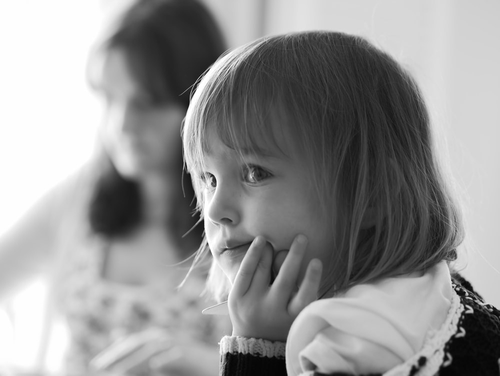 grayscale photo of girl in white long sleeve shirt