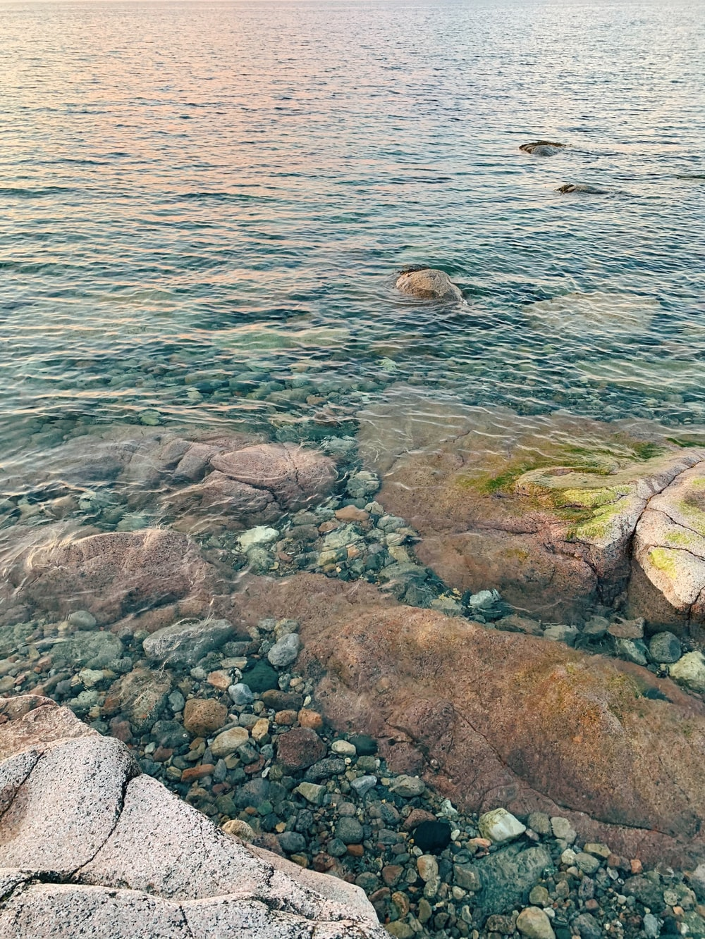 gray and brown rocks on body of water during daytime
