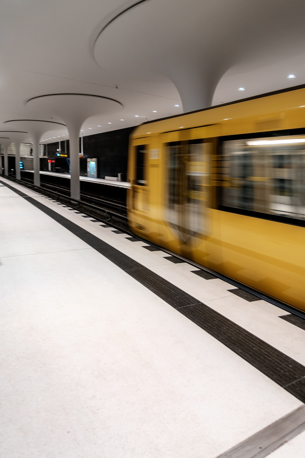 yellow and white train in train station