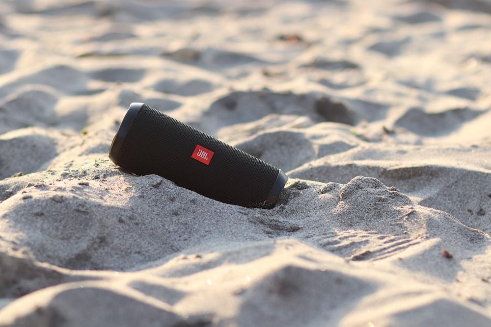 black and white plastic tube on sand