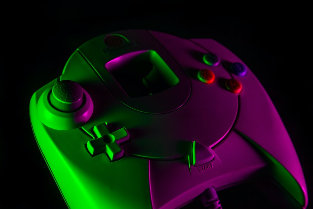purple game controller on black surface