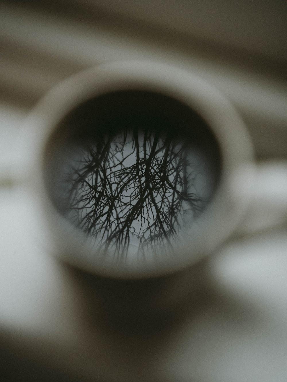 white ceramic mug with black liquid