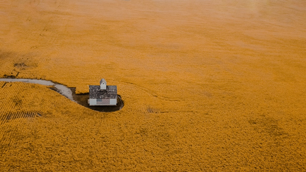 aerial view of gray building on brown sand