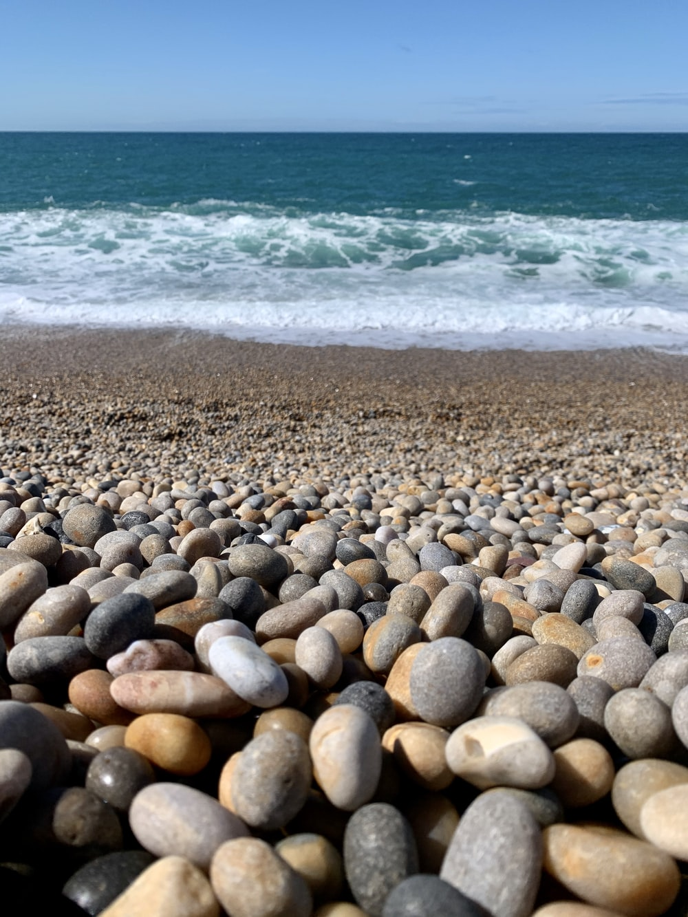brown and gray stones on beach during daytime