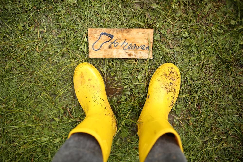 yellow rain boots on green grass