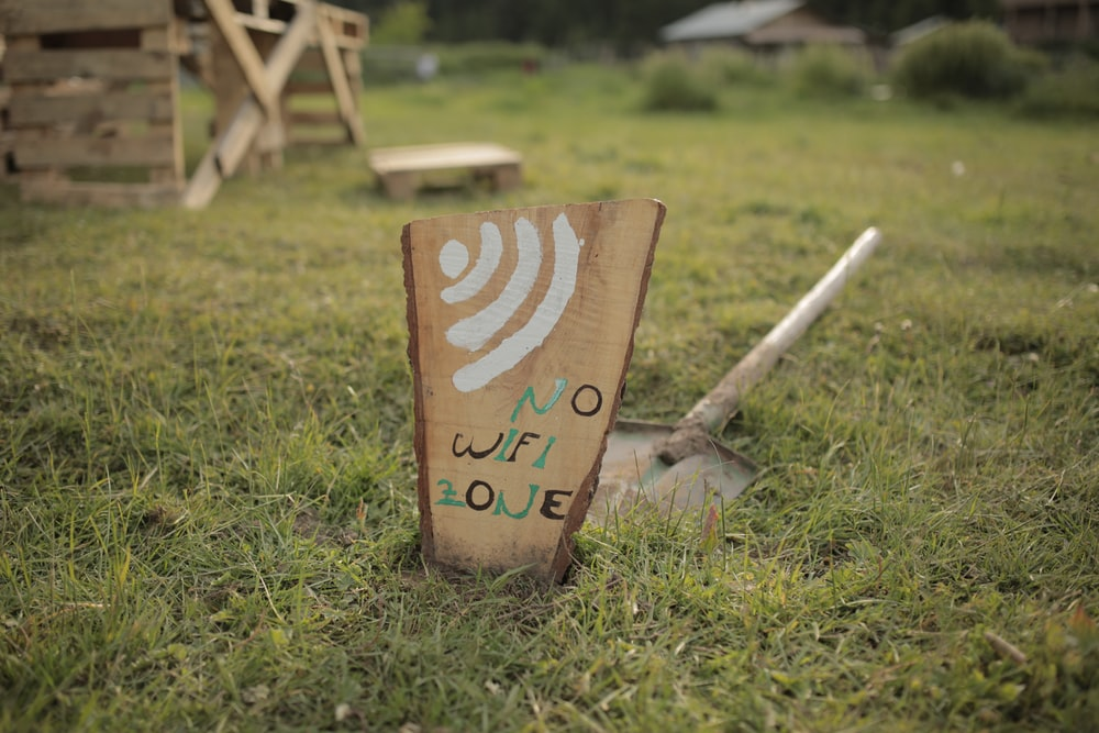 brown wooden i love you print board on green grass during daytime