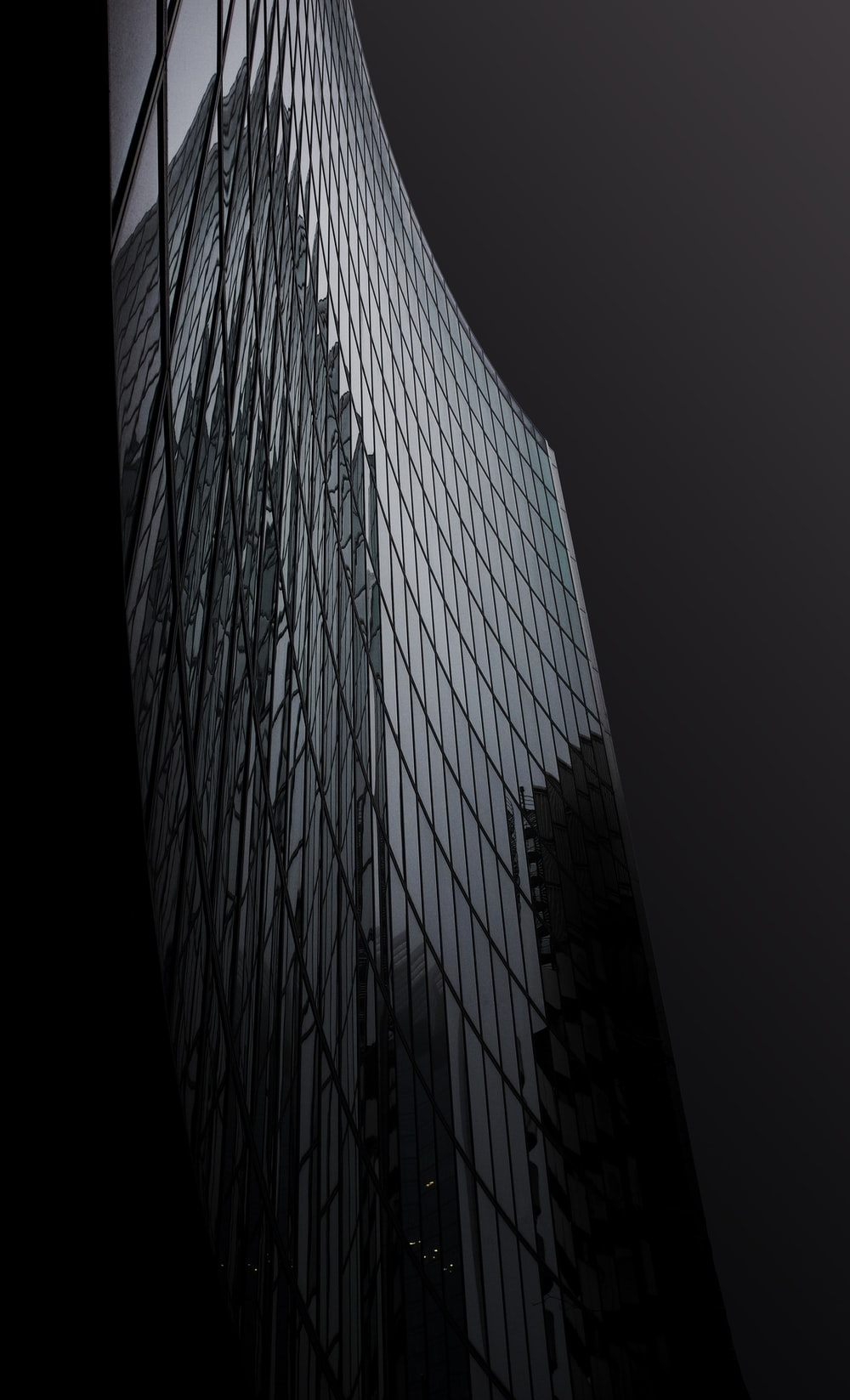 gray high rise building during night time