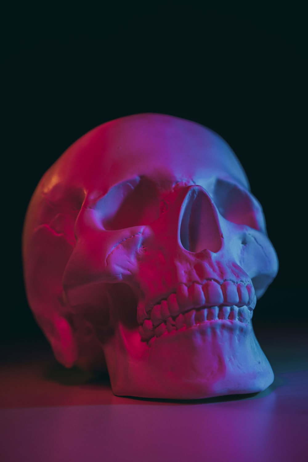 pink skull with black background