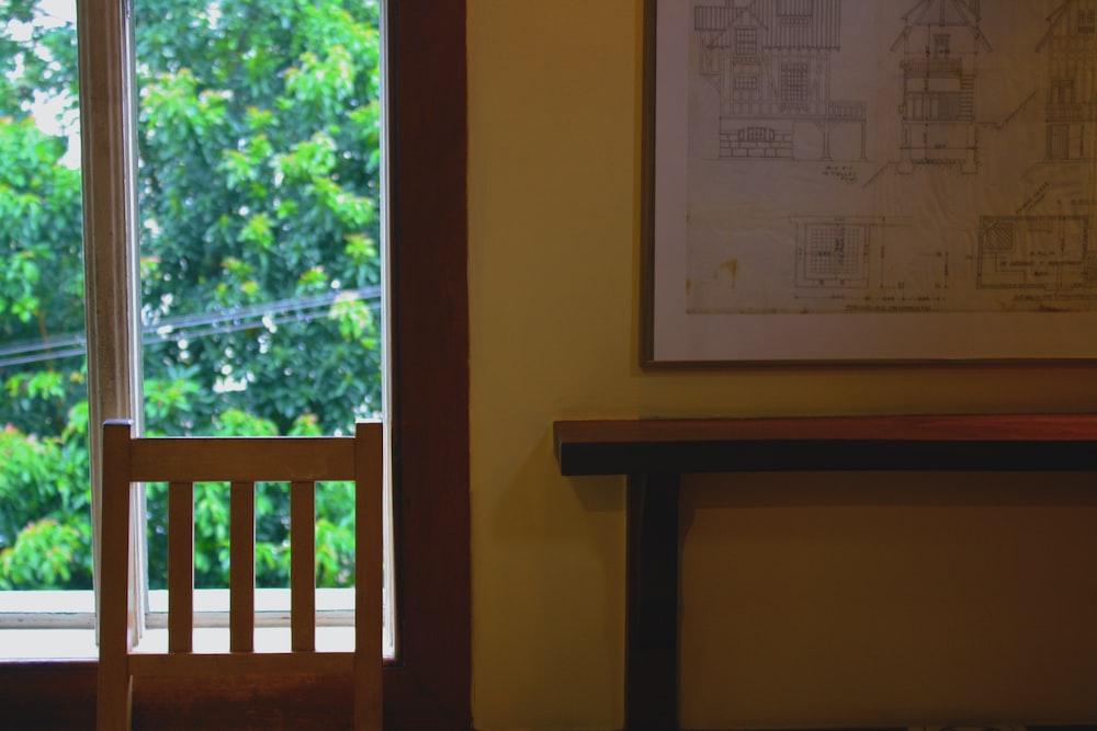 white printer paper on brown wooden window