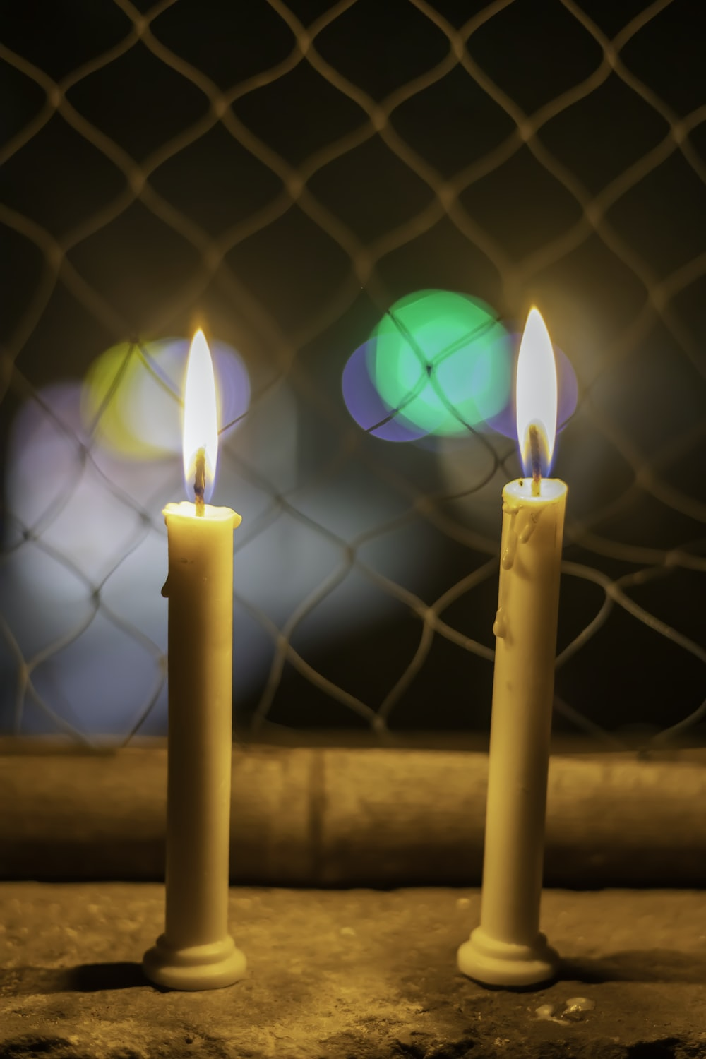 lighted candles on brown wooden surface