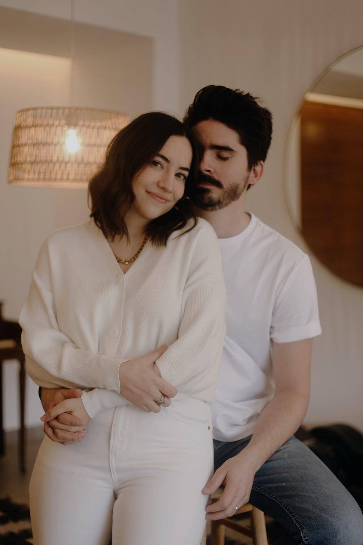 man in white button up shirt beside woman in white dress shirt