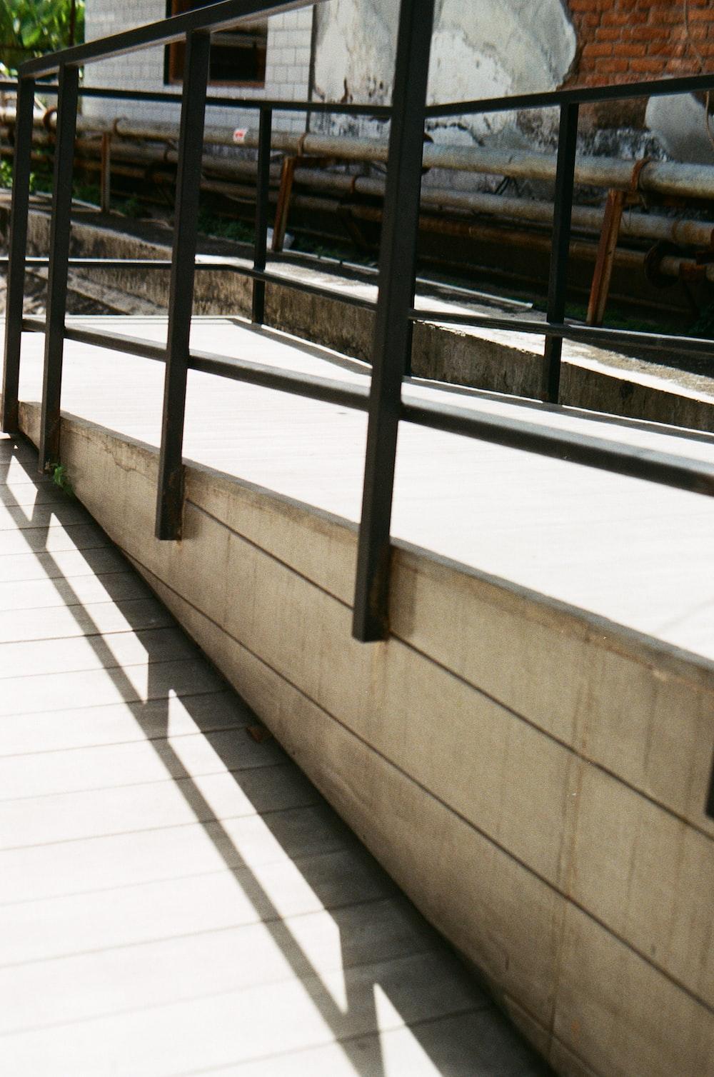 black metal railings on white floor tiles