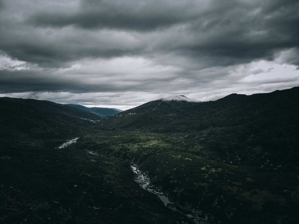 green mountains under cloudy sky during daytime
