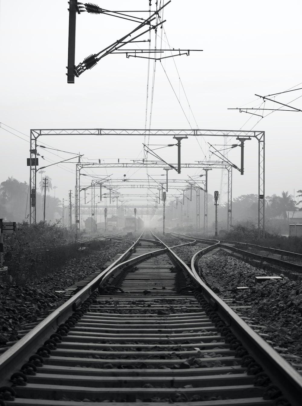 black metal train rail tracks