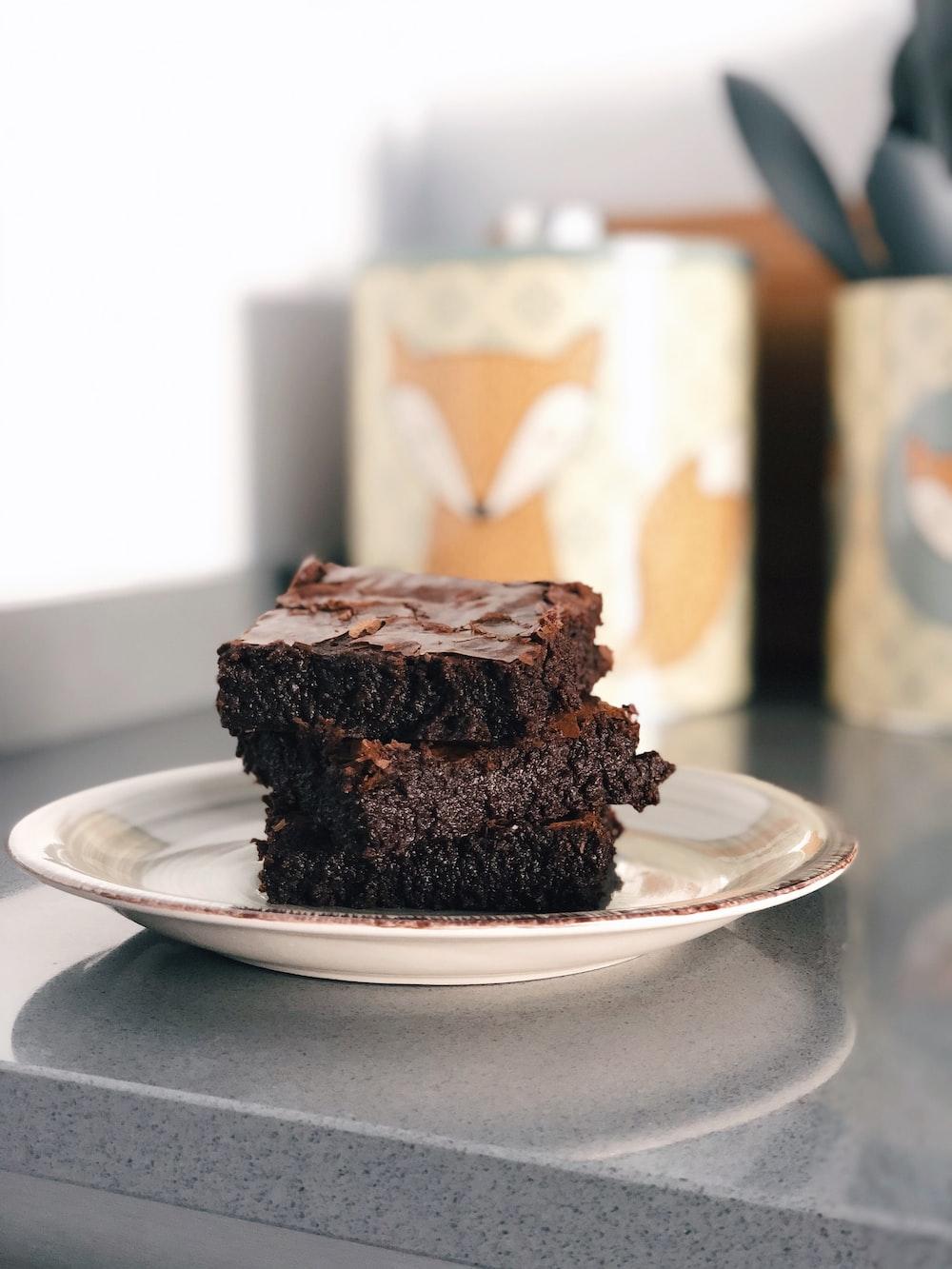 chocolate cake on white ceramic plate