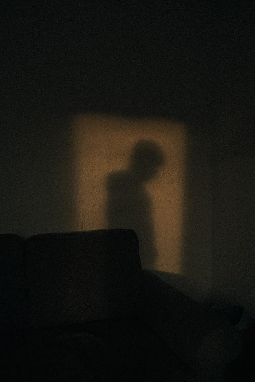 black sofa chair near white wall