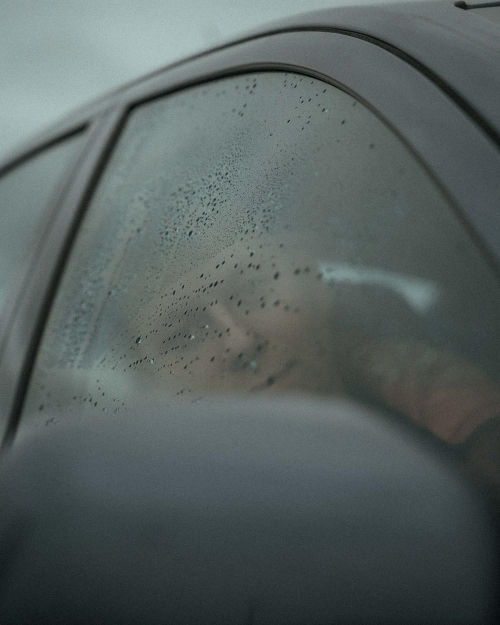 person in car side mirror