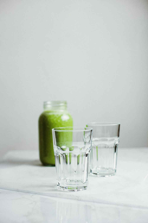 green fruit in clear glass jar