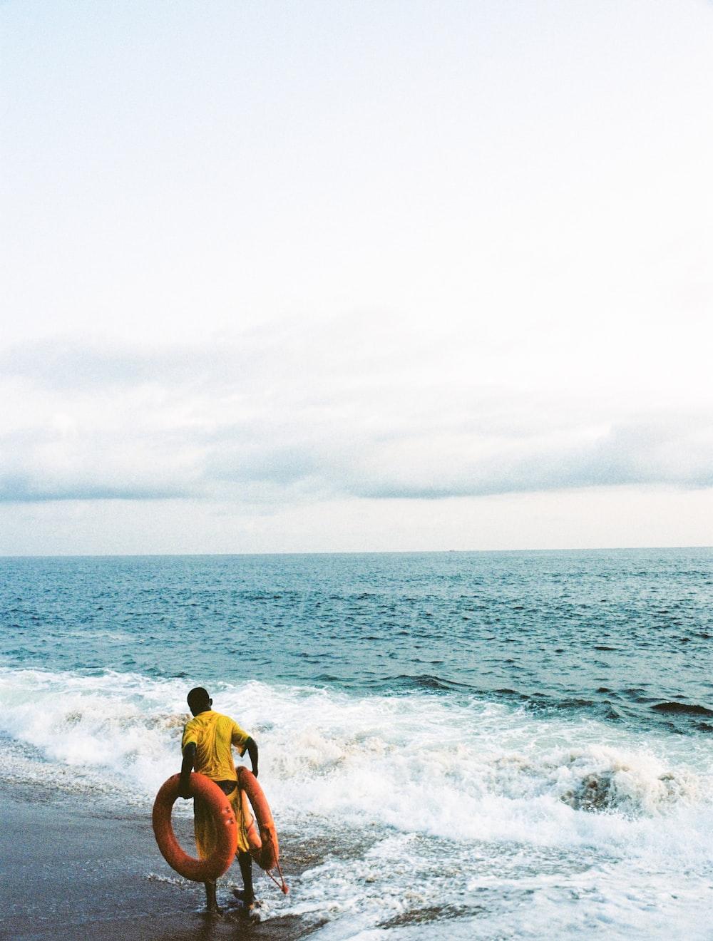 2 men in beach during daytime