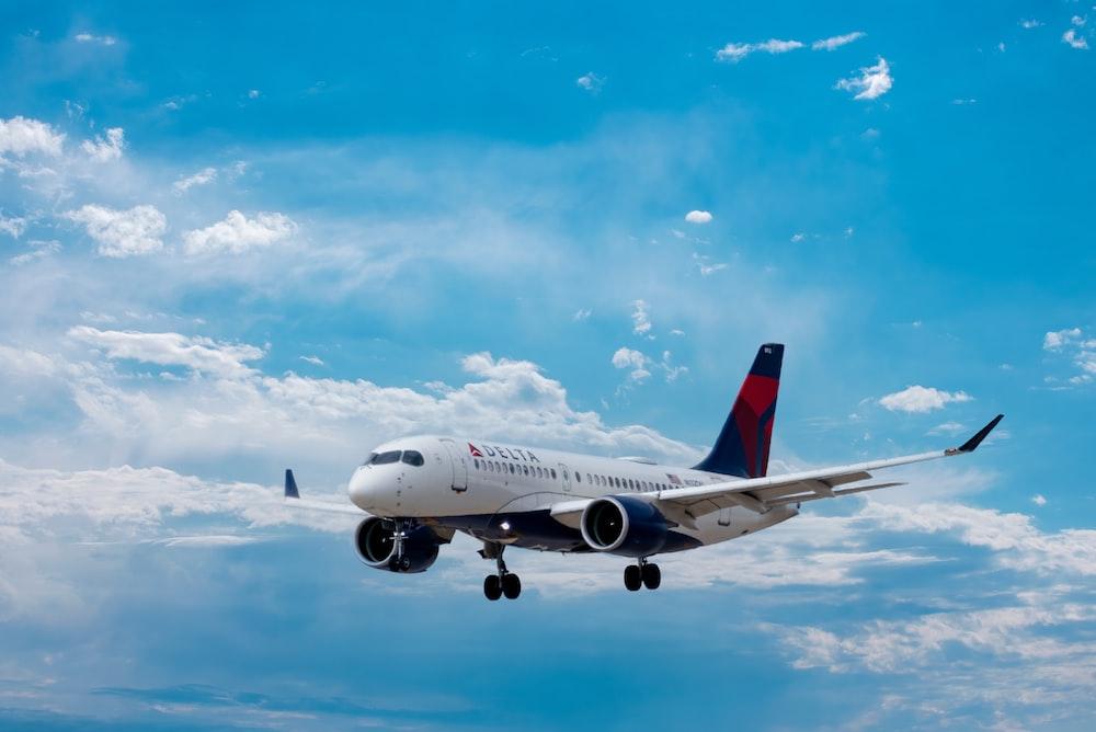 white passenger plane under blue sky during daytime