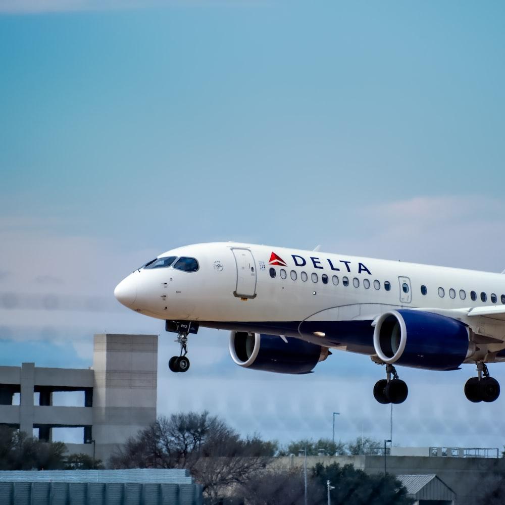 white passenger plane in the sky during daytime