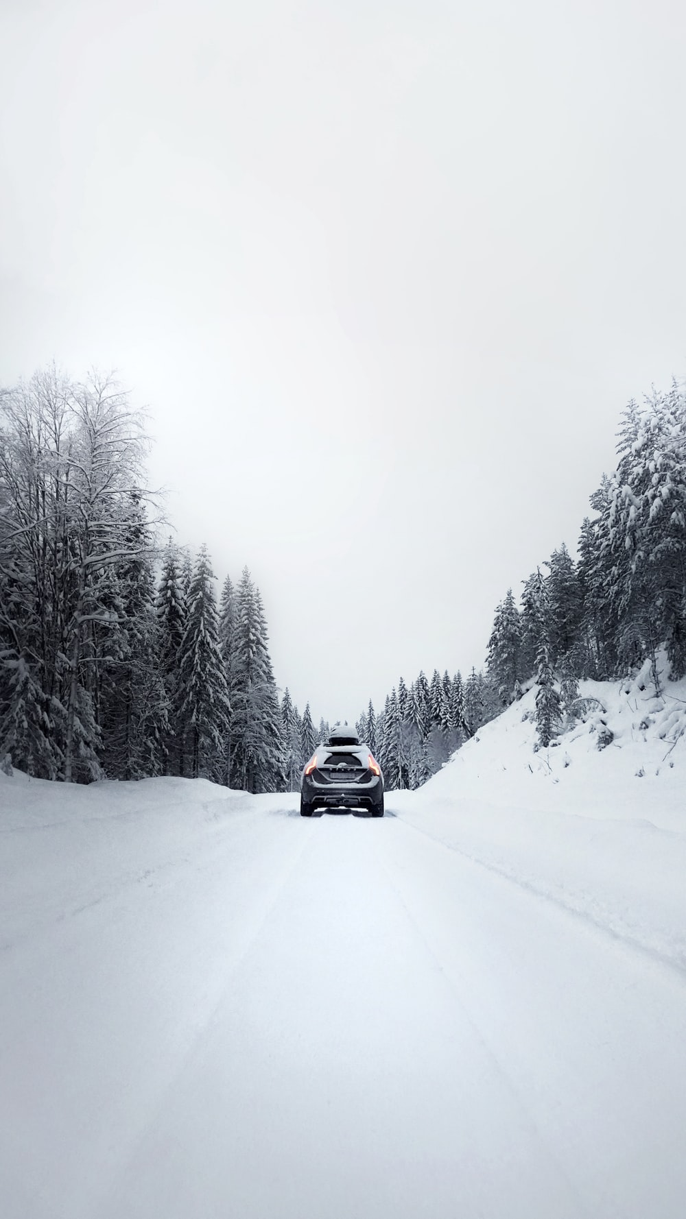 black car on snow covered road