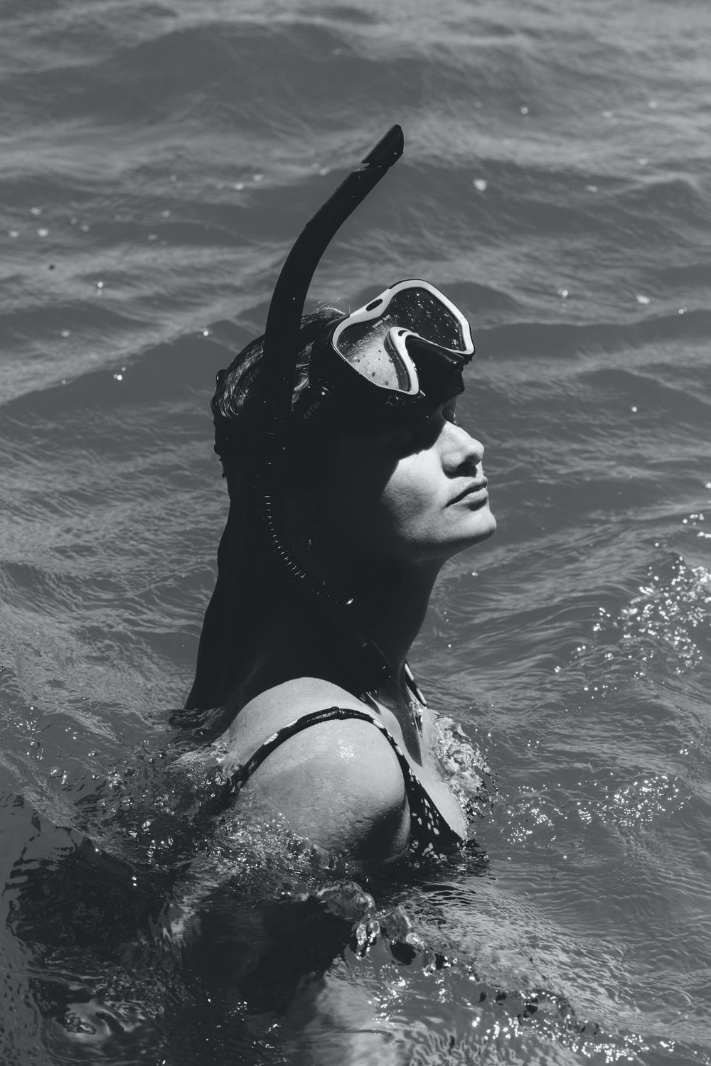 woman in black goggles in water