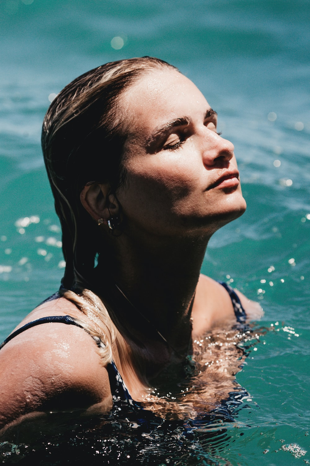 woman in white tank top in water