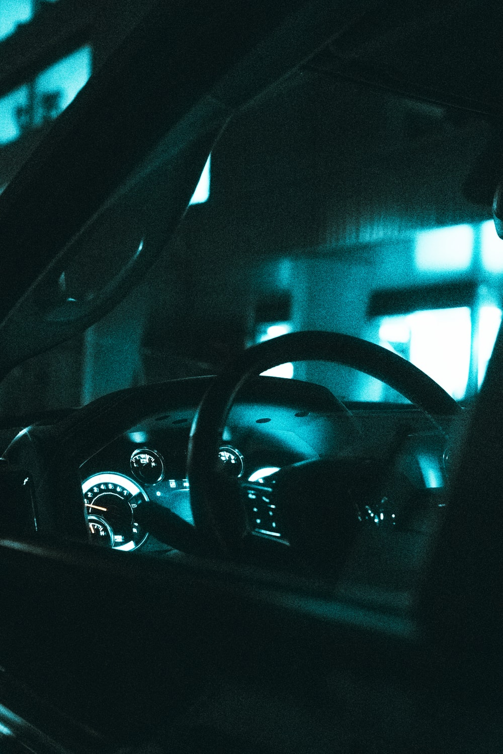 black steering wheel in close up photography