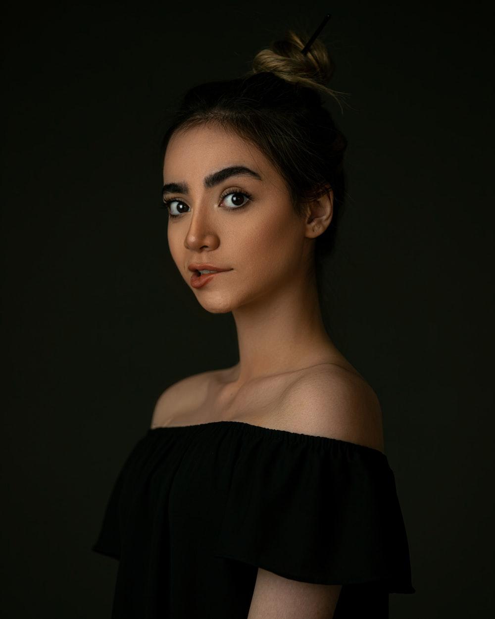 woman in black off shoulder top