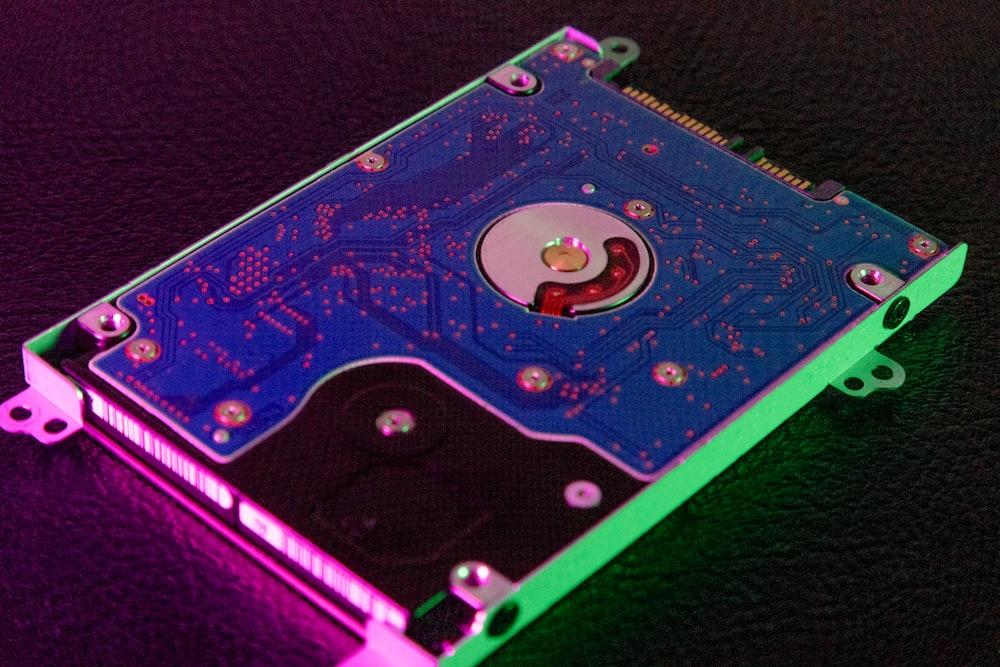 green and black hard disk drive