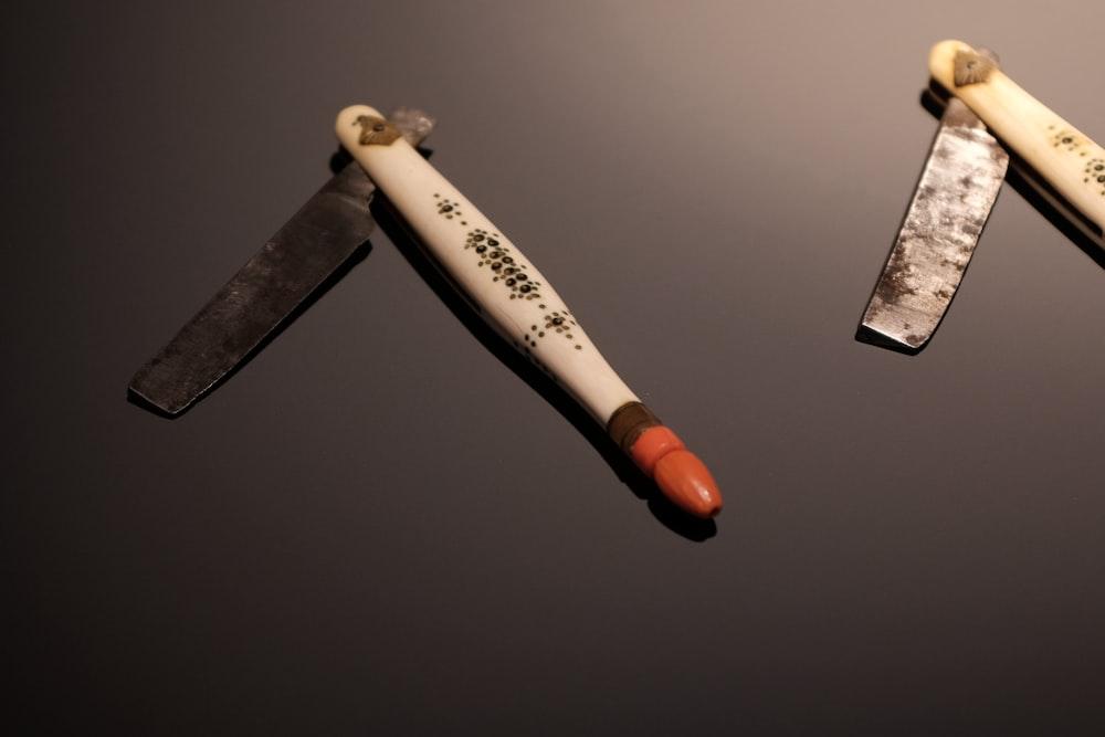 white and black hand tool