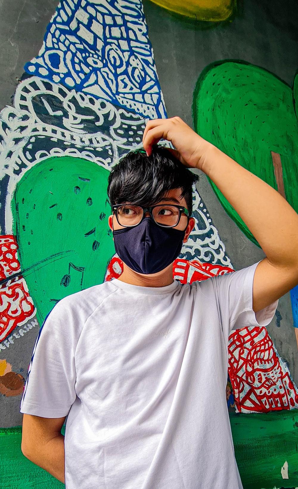 man in white crew neck t-shirt wearing black mask