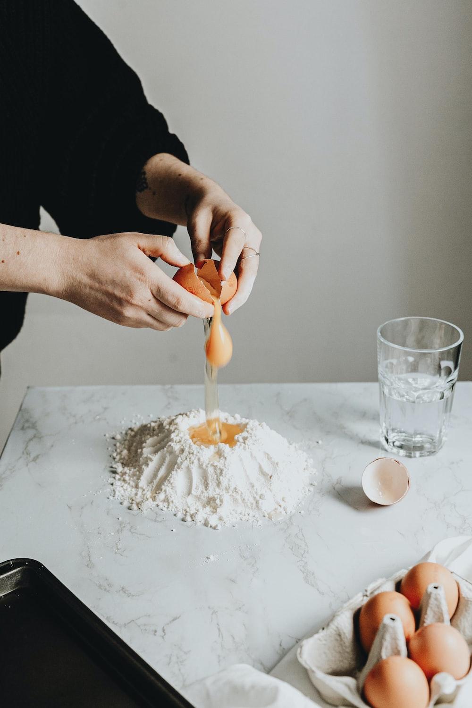 person holding a white cream