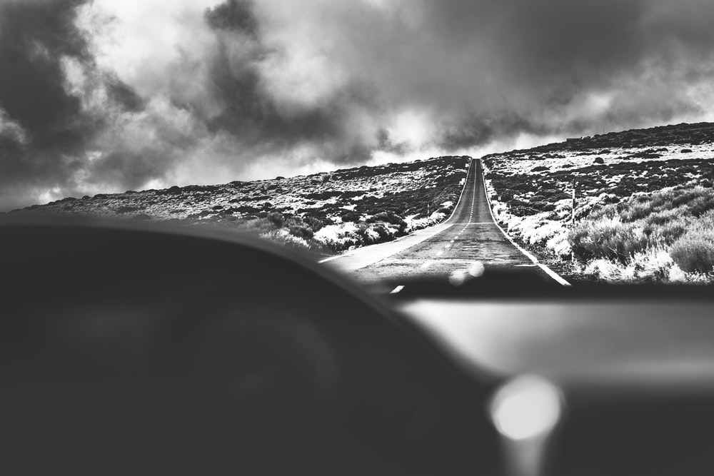grayscale photo of a road