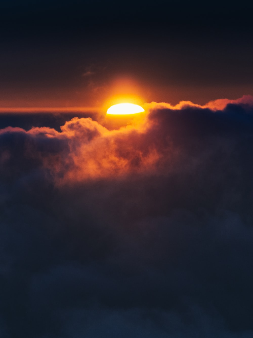 sun setting over the clouds