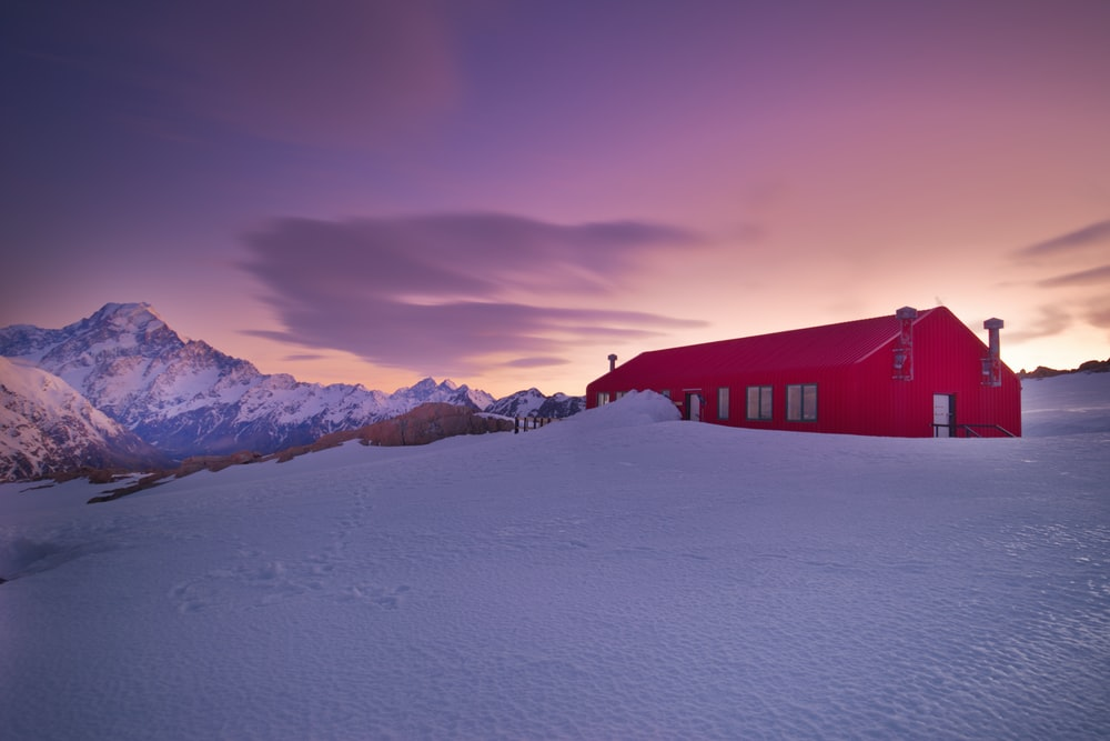 red house on snow covered ground
