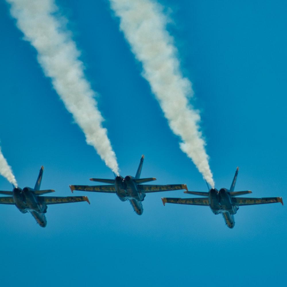 black jet plane in mid air during daytime