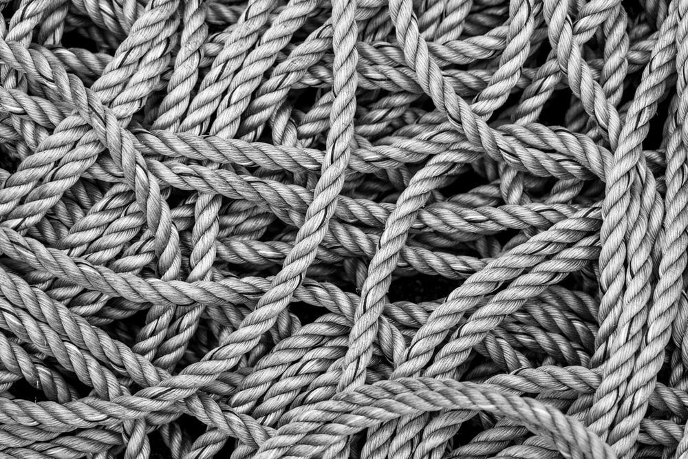 gray rope in grayscale photography