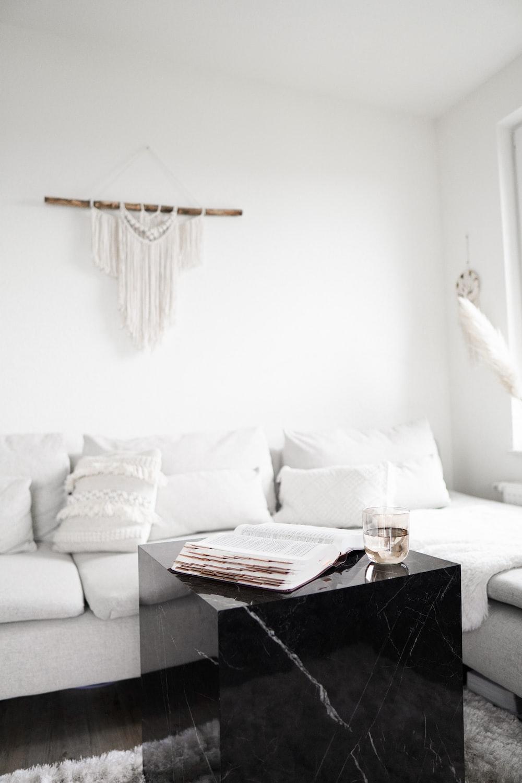 black wooden table near white sofa