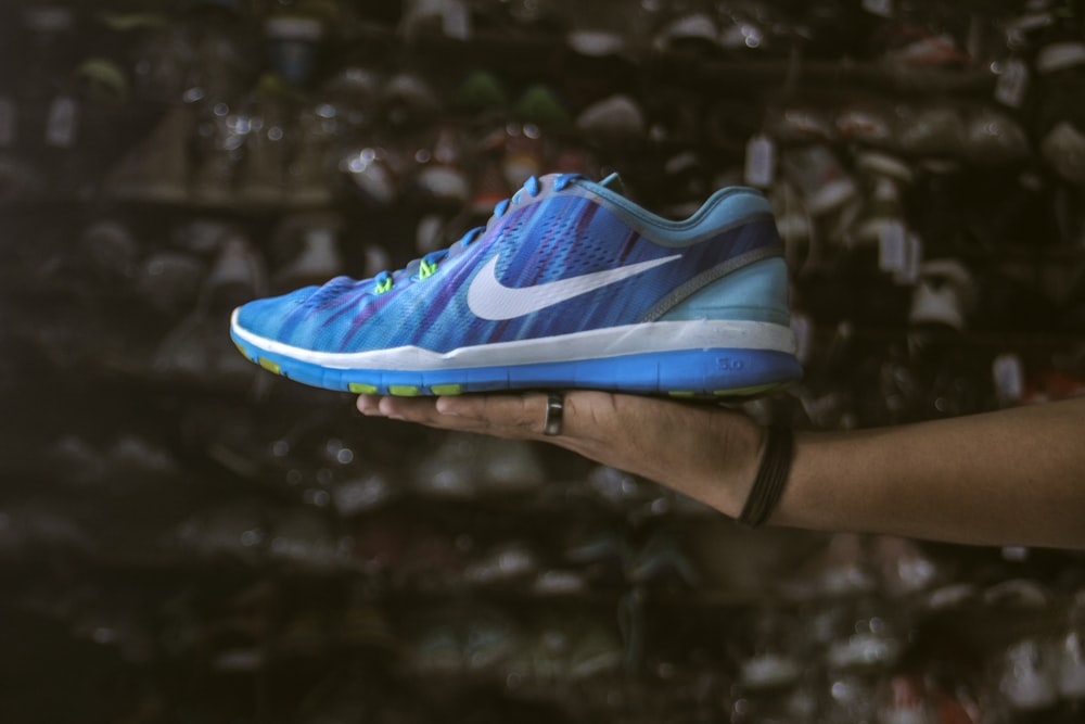 blue and white nike athletic shoe
